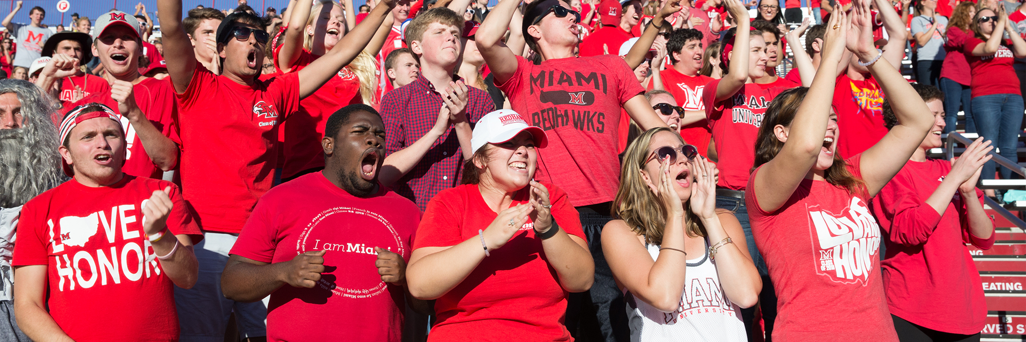 Students cheer on the Redhawks during a sporting event at Miami University.