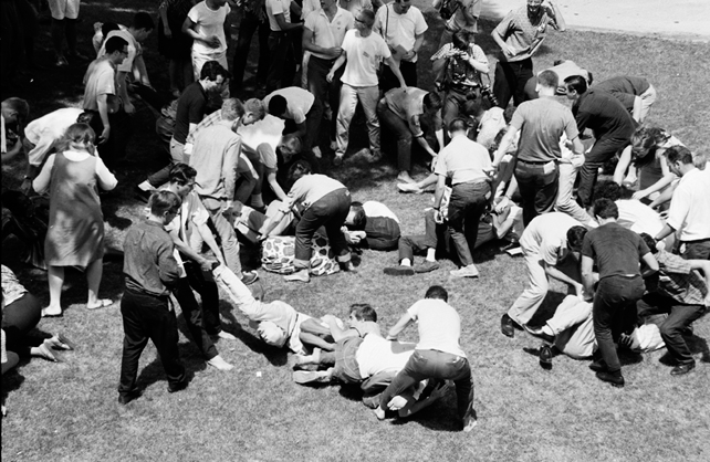 Freedom Summer Trainees curled up on the ground practicing non-violent resistance
