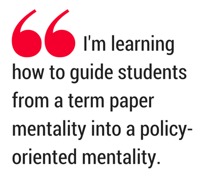 Emphasized quotation. Text: I'm learning how to guide students from a term paper mentality into a policy-oriented mentality.