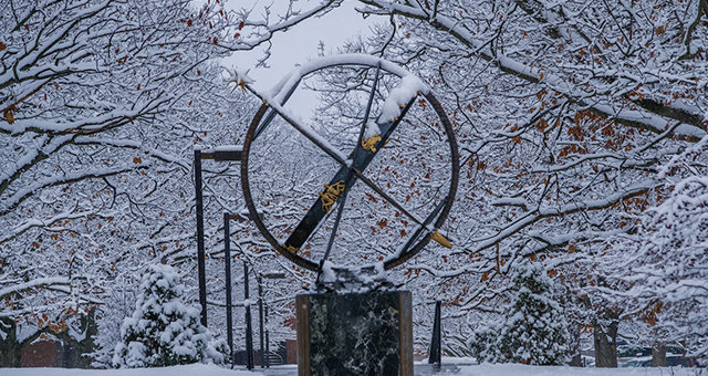 The Miami compass sculpture in a winter scene