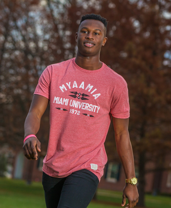 Heather red t-shirt. Design includes the ribbonwork mark. The word 'myaamia' arches over the words 'Miami University 1972'