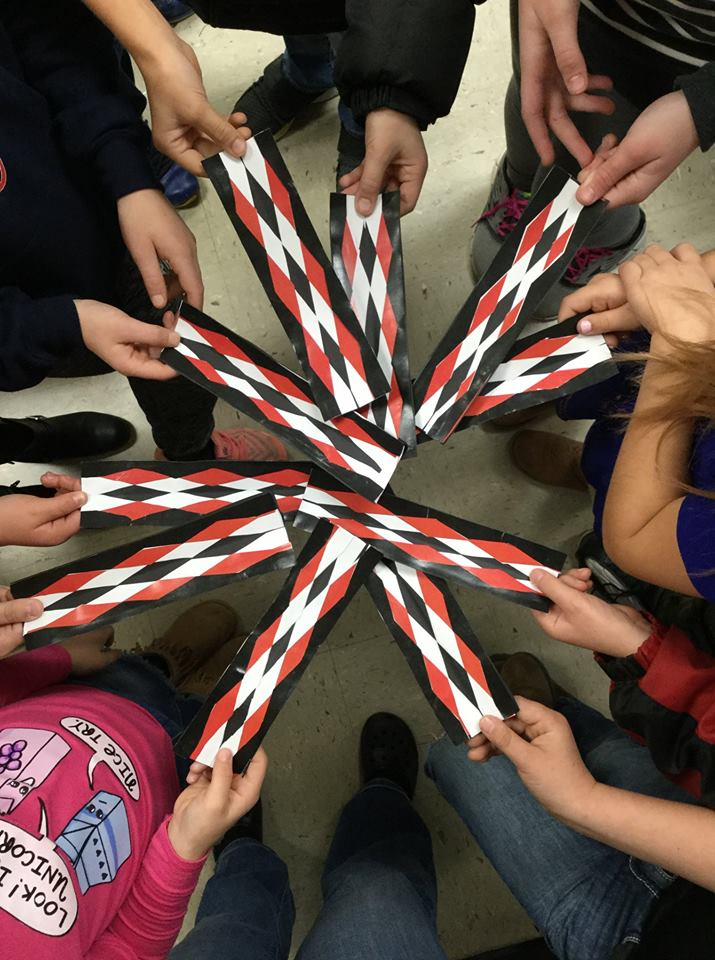 Children hold their bookmarks in a spoke pattern