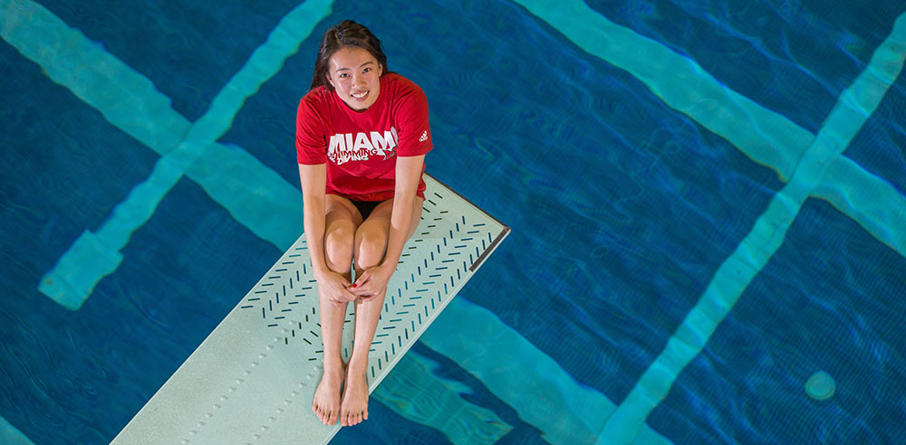 Pei Lin, a public health major, is a three-time winner of both the one-meter and three-meter springboard events at the Mid-American Conference (MAC) Championships (all photos by Scott Kissell).