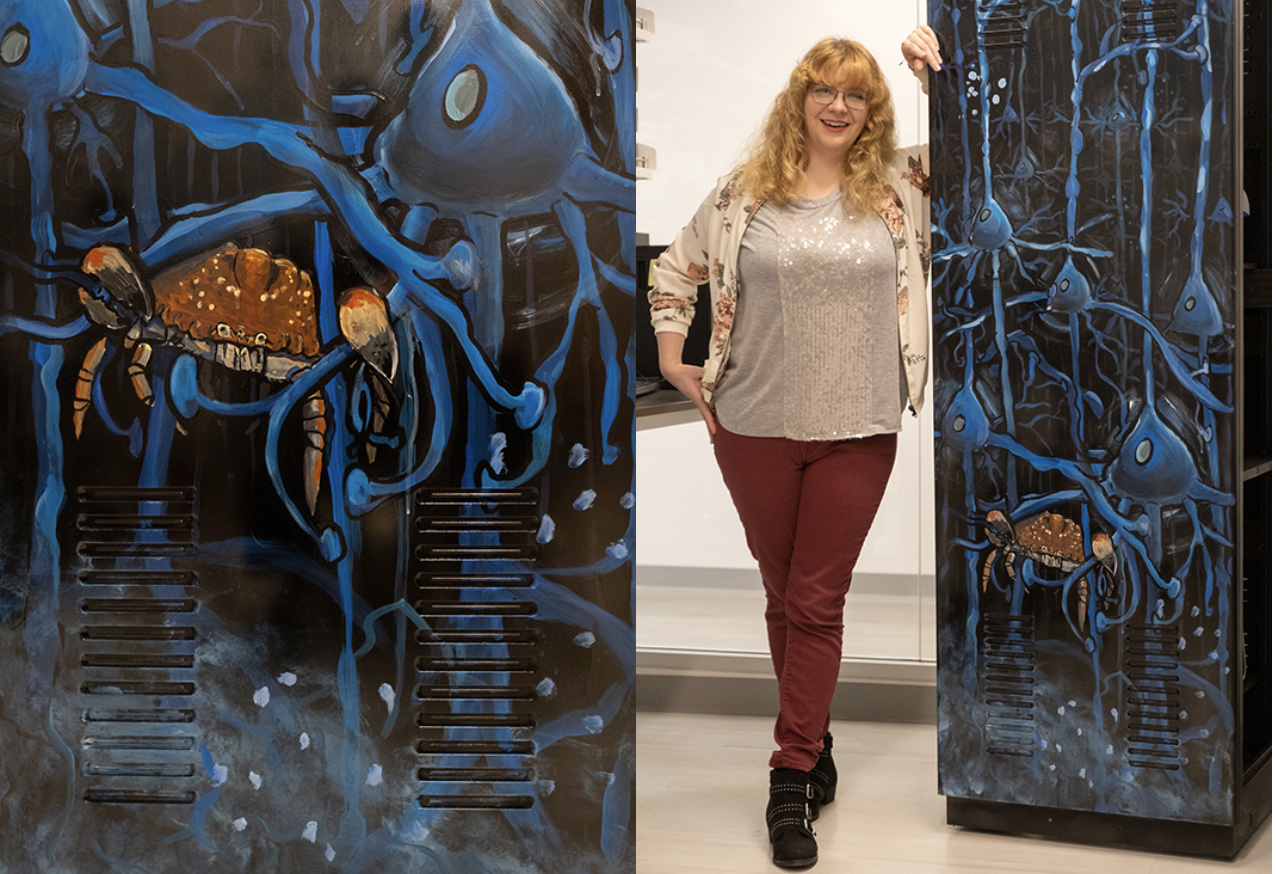 Amanda Rainey (Miami '13), graduate student in neurobiology with adviser Dawn Blitz, poses with her artwork, a (much) larger-than-life depiction of her research.