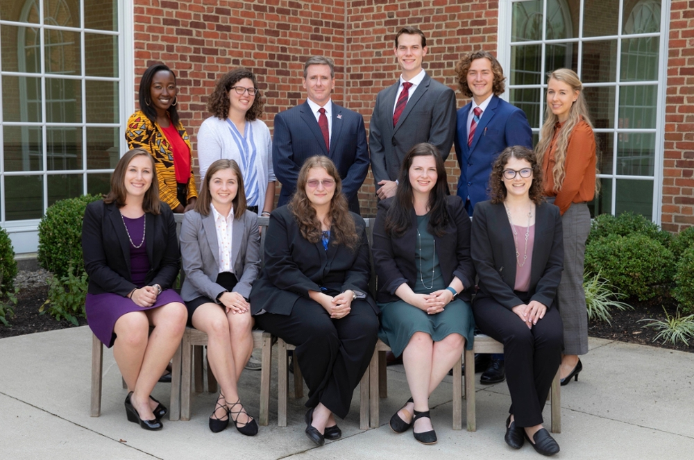 Top row, left to right: Alison Tuiyott, Shelby Frye, Provost Jason Osborne, Joseph Braun, Mitchell Singstock and Emily Kuehl. Bottom row, left to right: Taylor Gordon, Rachel Ollier, Rosie Ries, Allyson Heitger and Mackenzie Trevethan.