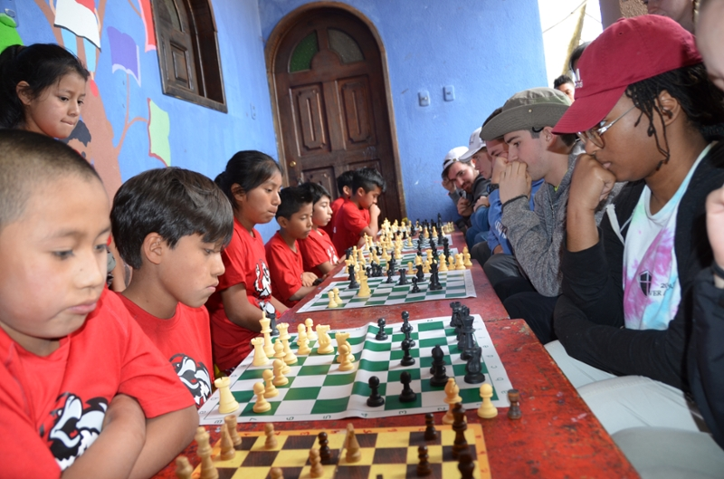 To engage with the Centro Explorativo, a volunteer-run school in Guatemala, Miami University engineering students participated in a grand chess tournament with the young students. Graduate student Michael Larson is fourth down the row in the white ball cap.