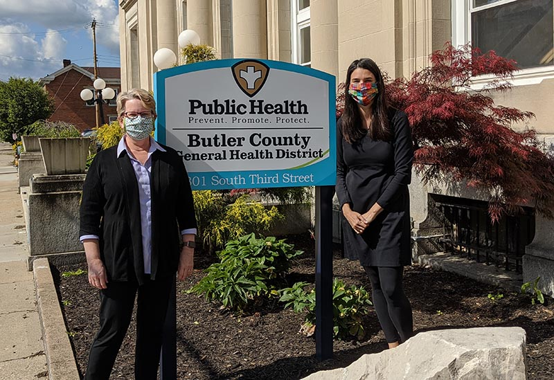 Kendall Leser (left), director of Miami's public health program, works with Jennifer Bailer (Miami '81), Butler County health commissioner.