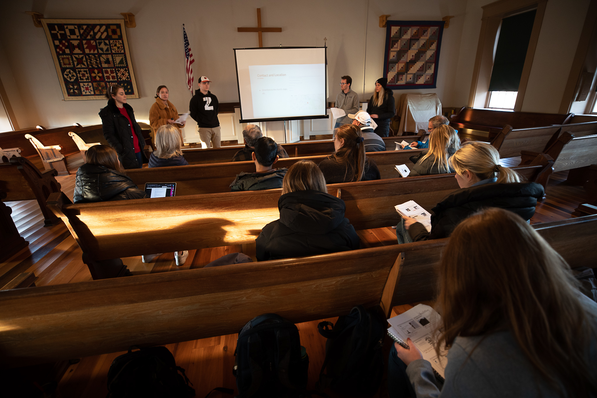 Miami students present ideas to HHC trustees inside the church sanctuary.