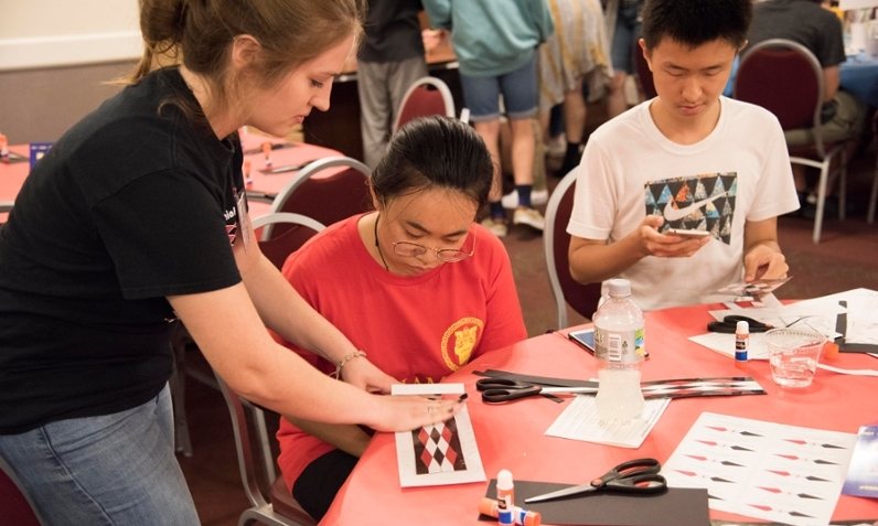 Miami University students attend Art After Dark in 2017 and learn to make bookmarks inspired by Myaamia ribbonwork.