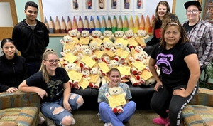 Regionals students with bears they made for foster children