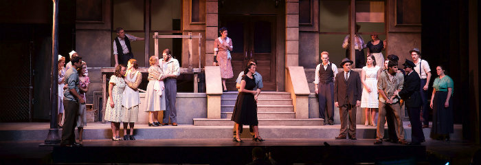 Actors onstage in a scene from Street Scene Theatre, CCA
