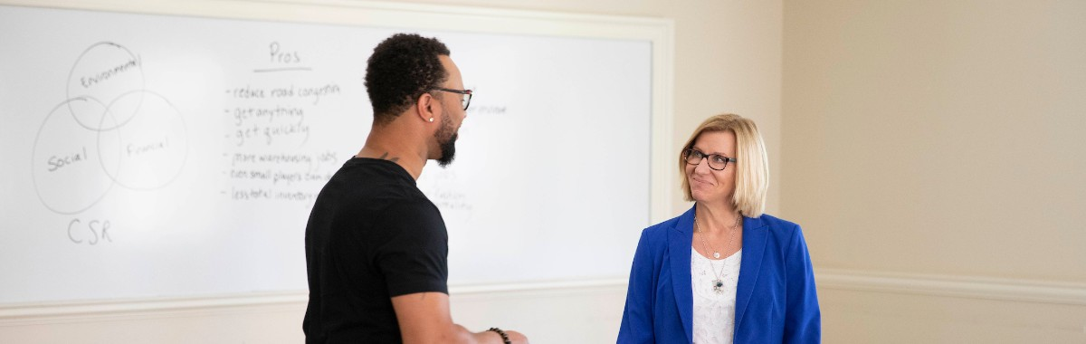 FSB's Professor Ellram converses with student in her class