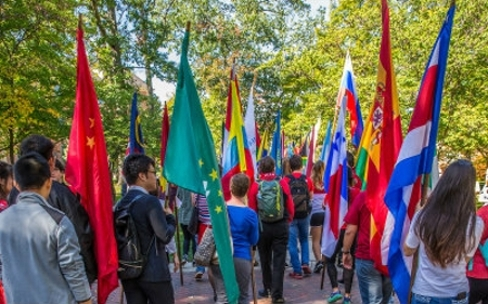 students carrying flags at the hub
