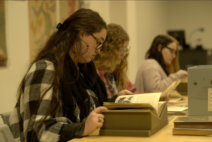 students reading in archive