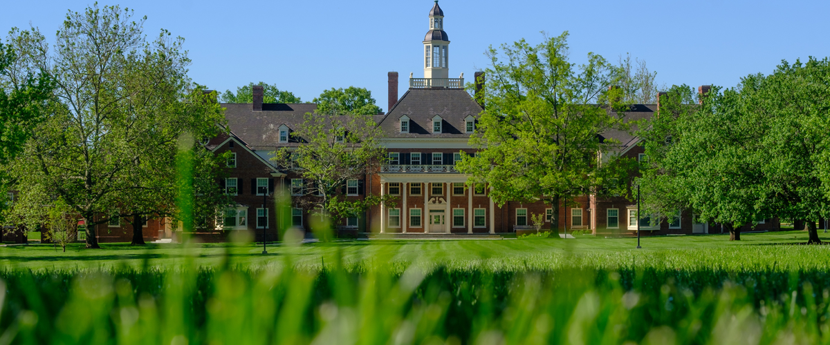 a view of maccracken hall from a low camera angle in the grass