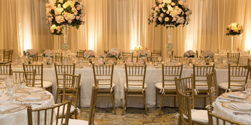Shown is a photo of a event hall set up for a wedding