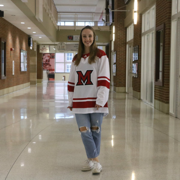 Woman wearing Miami Hockey jersey