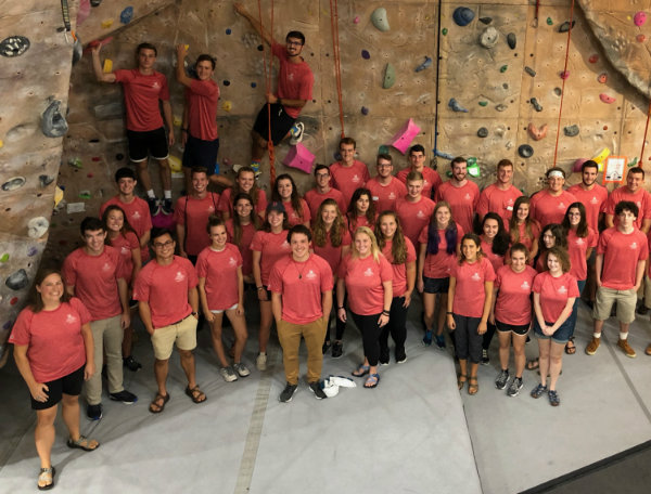 Recreation staff in front of climbing wall