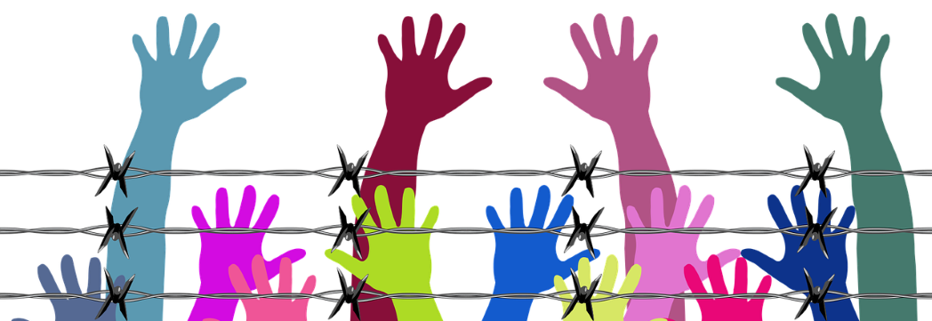 drawing of hands reaching above barbed wire