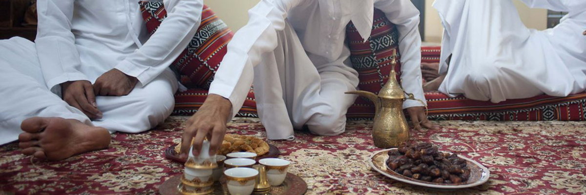 Arab Men Share Tea and Dates