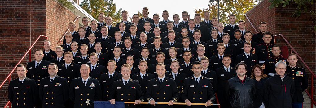 formal photo of Miami NROTC staff and students