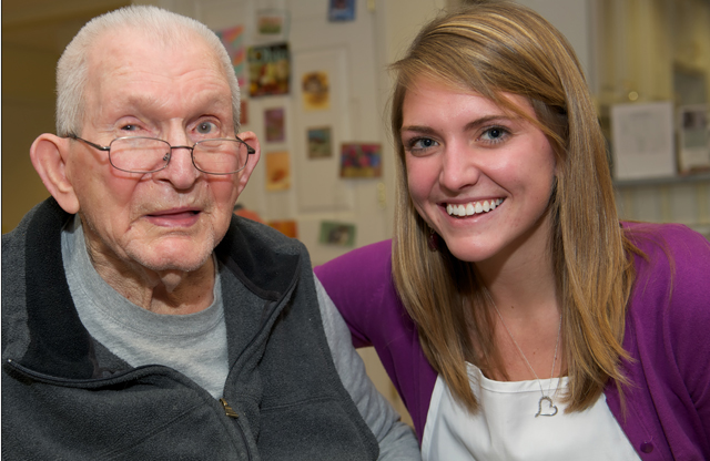 An elder with dementia and his volunteer partner from Opening Minds through Art