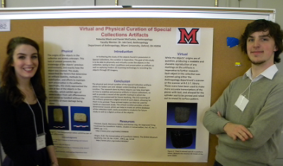 Becka Mock and Daniel McClurkin stand in front of their poster at the Undergraduate Research Forum
