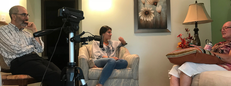Dr. Gray and a student conduct a filmed interview of a WBC member in her home