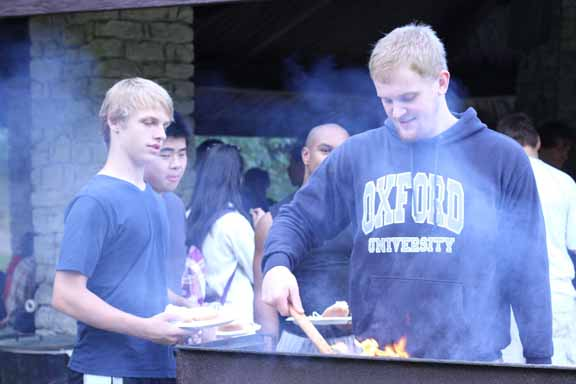 President Ethan Clements grilling at the picnic