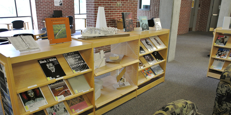Shelves displaying periodicals and architectural models