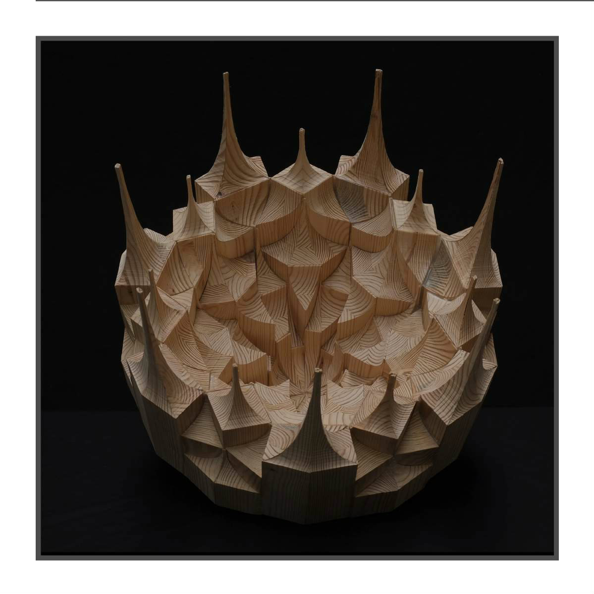 wooden sculpture with spikes