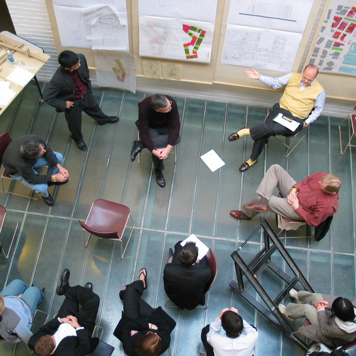 overhead view of a student's work being critiqued in the atrium of Alumni Hall