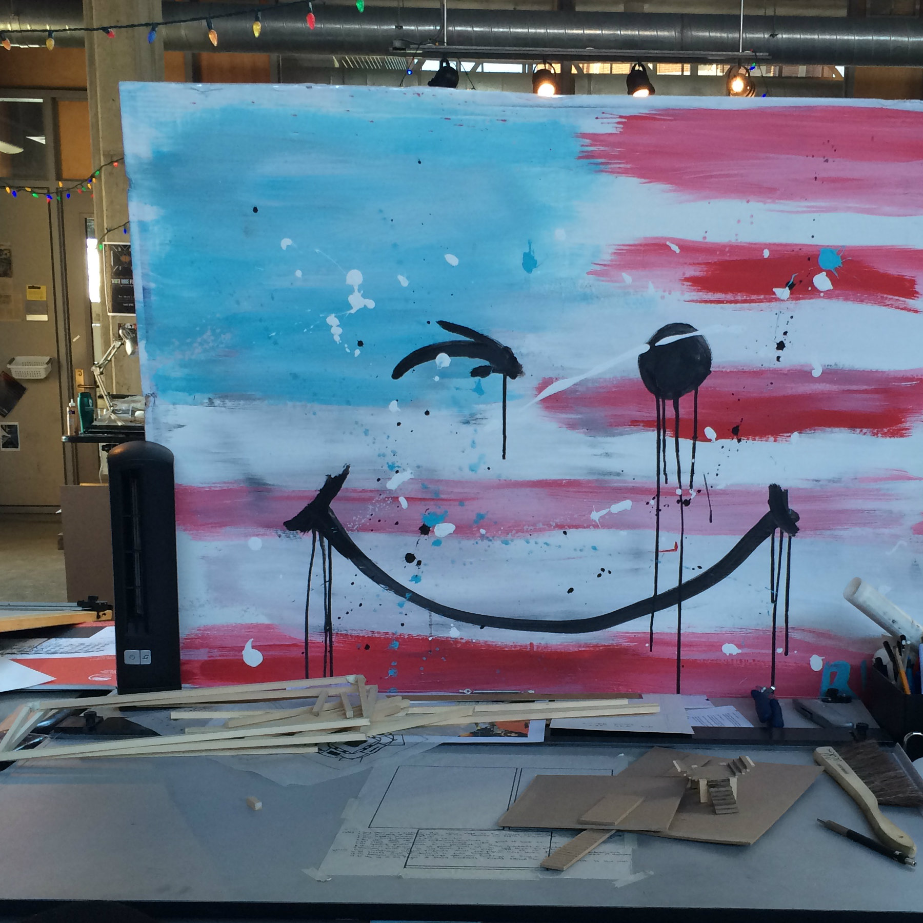 painting of an American flag with a smiley face