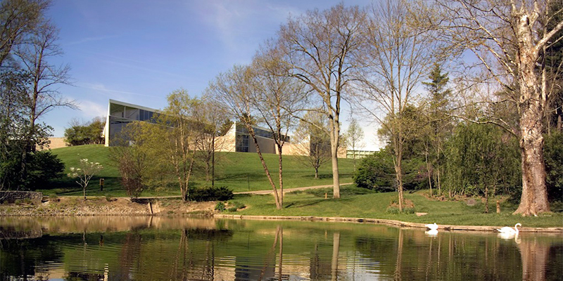 A view of the Art Museum exterior as seen from the pond