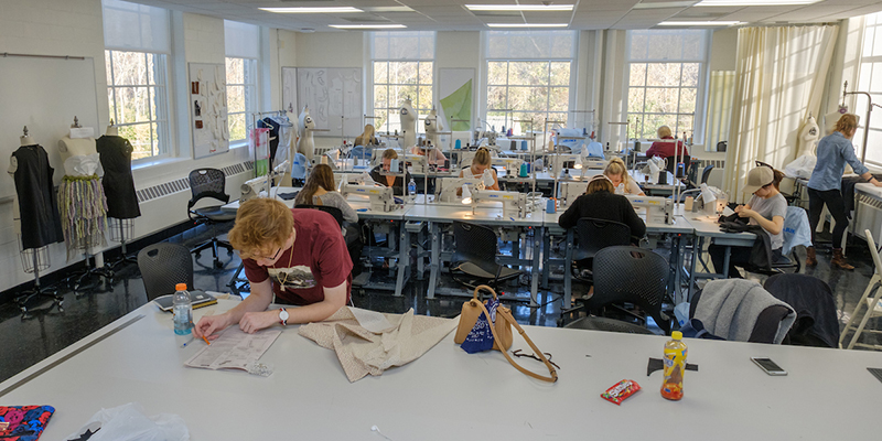 Long shot of students working in the fashion design classroom