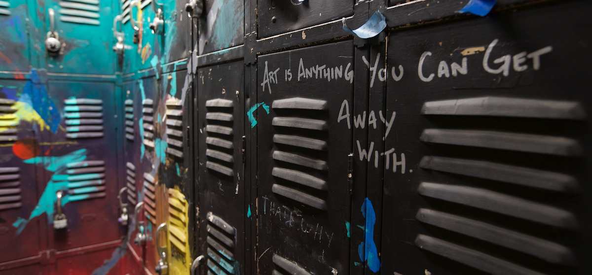Art Building lockers, decorated with slogans and colorful paint