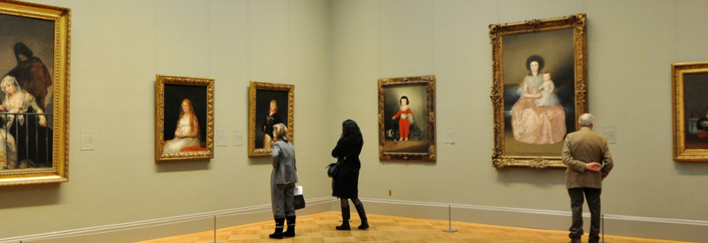 Patrons look at European Art in the Metropolitan Museum of Art in NYC