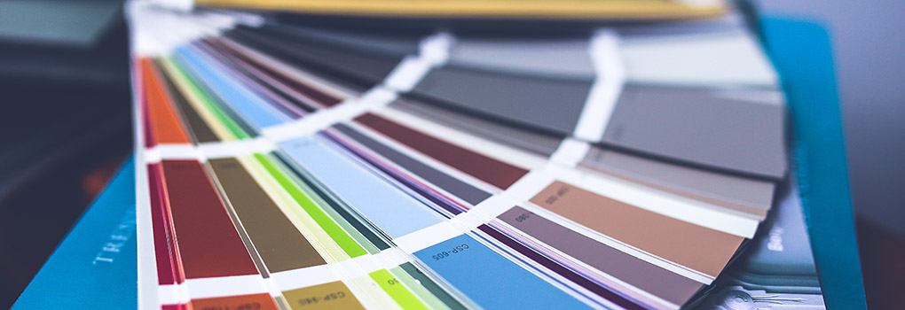 a Pantone book of color swatches is fanned out