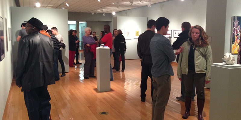 People visit an exhibit in the Hiestand Galleries