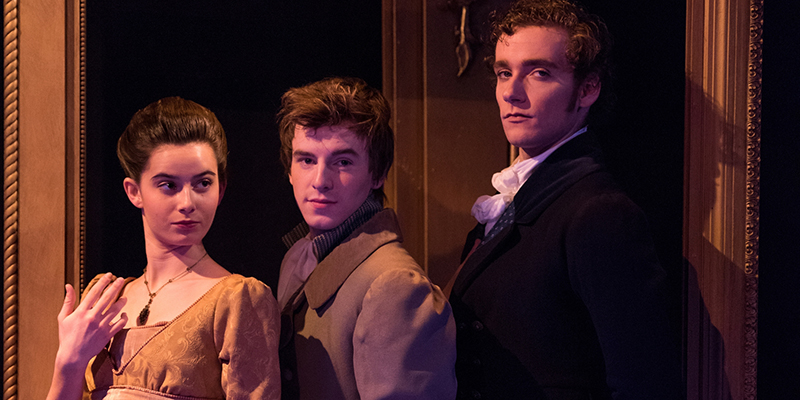Three actors with sly expressions pose in a scene from Miami Theatres production of Pride and Prejudice