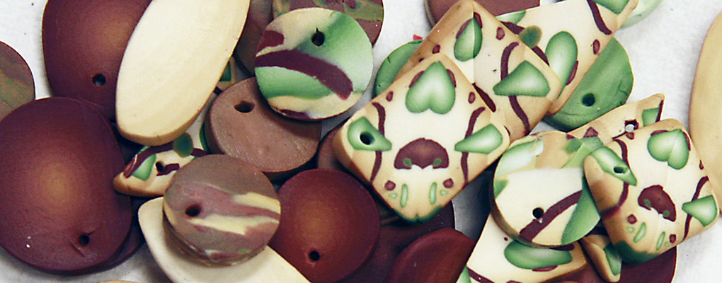 Polymer clay beads arranged on a surface