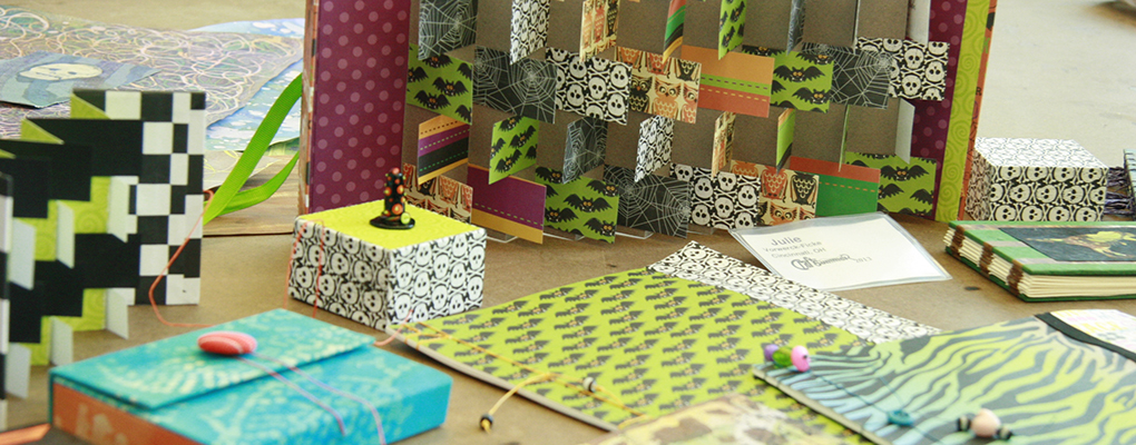Colorful examples of 2D and 3D papercraft, including boxes and bookbinding
