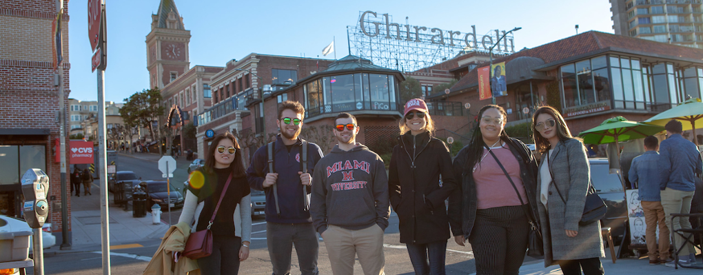 group of students pose near the Ghirardelli building, San Francisco