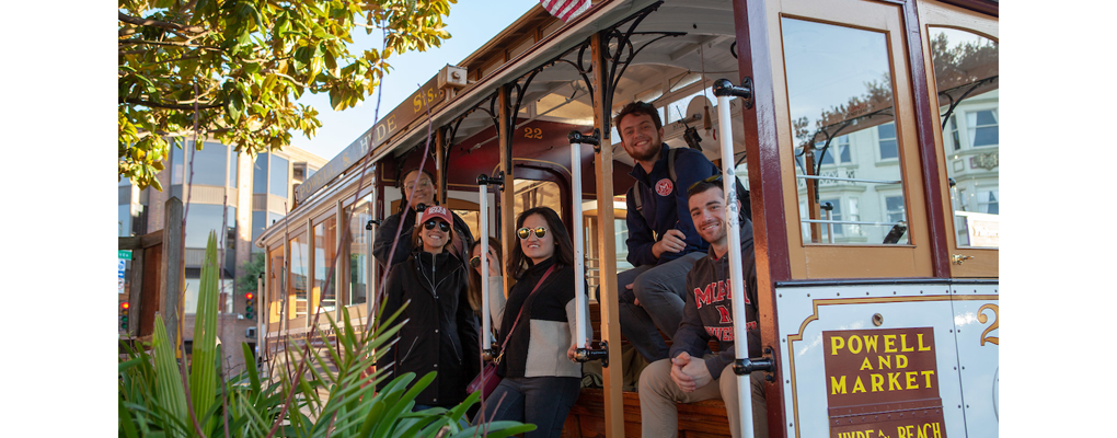 Students pose on a cable car