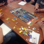 Players at a table playing game From Earth to Mars