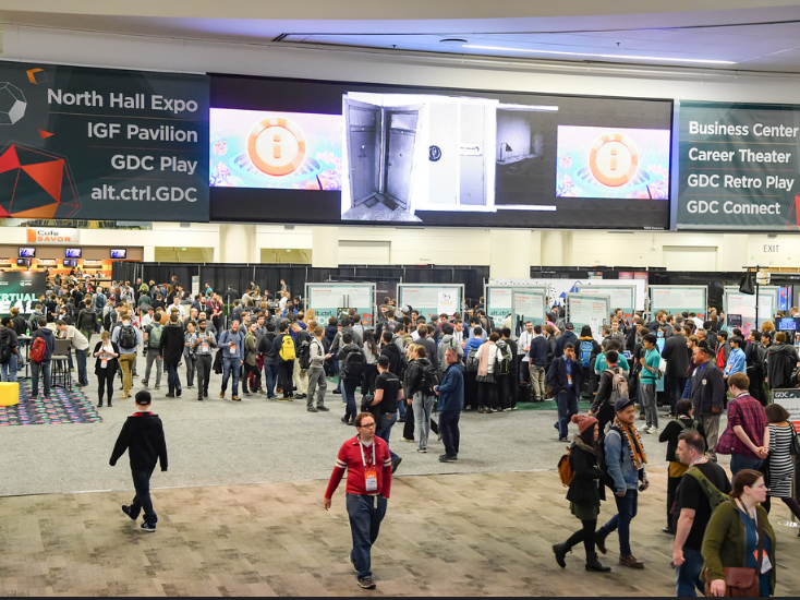 The GDC logo is superimposed over a crowd shot of the conference