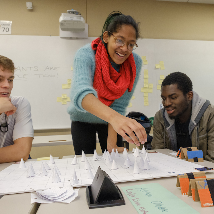 Students in a design thinking class play a game