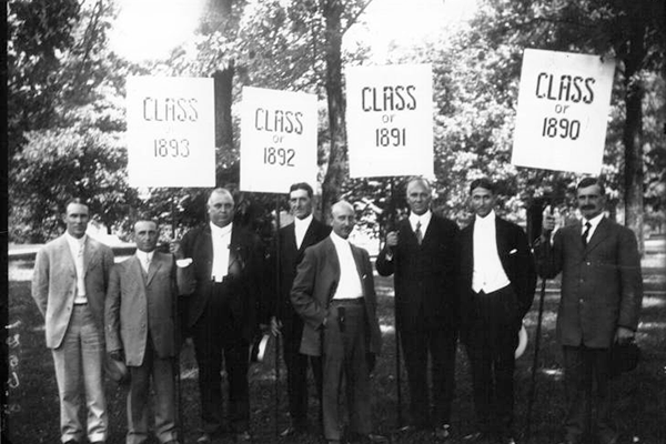 1890s commencement with men holding class signs