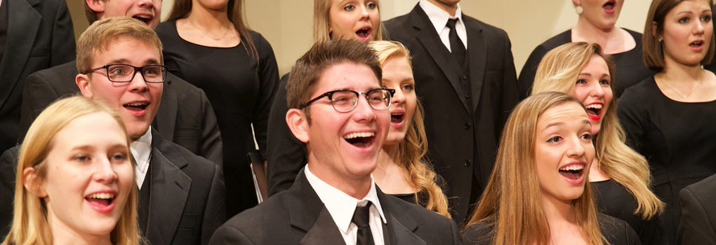 Combined Glee Club and Chorale singers perform with enthusiasm at Hall Auditorium