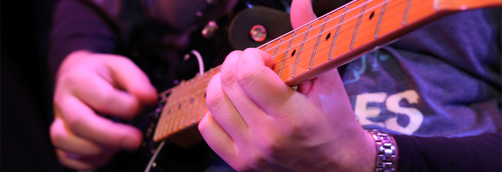 Closeup of a jazz guitarist's hands during a performance